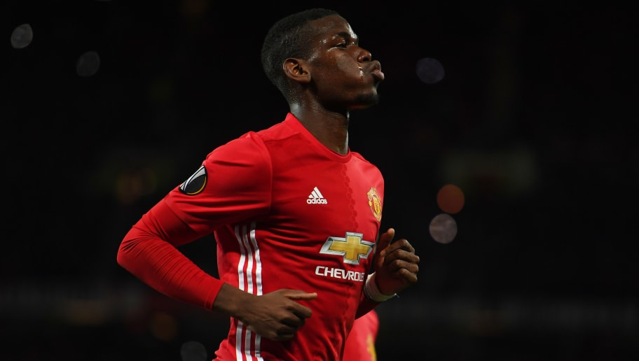 MANCHESTER, ENGLAND - OCTOBER 20:  Paul Pogba of Manchester United celebrates after scoring the opening goal from the penalty spot during the UEFA Europa League Group A match between Manchester United FC and Fenerbahce SK at Old Trafford on October 20, 2016 in Manchester, England.  (Photo by Laurence Griffiths/Getty Images)
