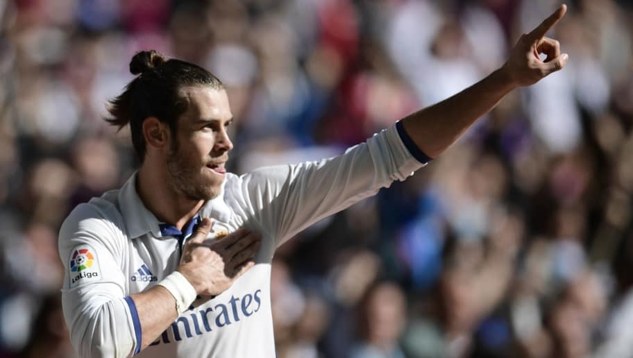 Real Madrid's Welsh forward Gareth Bale celebrates after scoring a goal during the Spanish league football match Real Madrid CF vs Club Deportivo Leganes SAD at the Santiago Bernabeu stadium in Madrid  on November 6, 2016. / AFP / JAVIER SORIANO        (Photo credit should read JAVIER SORIANO/AFP/Getty Images)