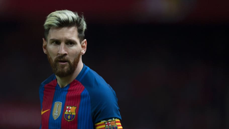 Barcelona's Argentinian forward Lionel Messi looks on during the Spanish league football match Sevilla FC vs FC Barcelona at the Ramon Sanchez Pizjuan stadium in Sevilla on November 6, 2016. / AFP / JORGE GUERRERO        (Photo credit should read JORGE GUERRERO/AFP/Getty Images)
