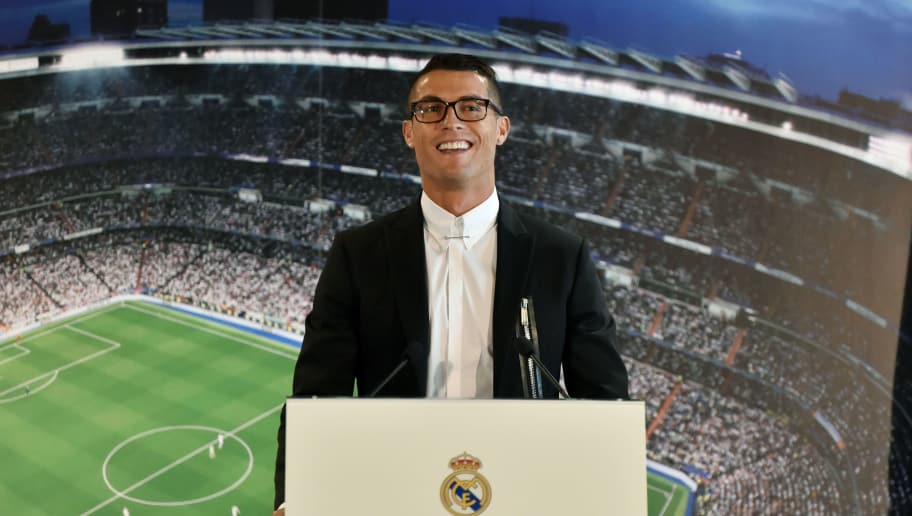Real Madrid's Portuguese forward Cristiano Ronaldo a speaks during the official presentation of his contract renewal, in the presidential box at the Santiago Bernabeu stadium in Madrid on November 7, 2016.  Real Madrid and Cristiano Ronaldo have agreed an extension to the player's contract, keeping him at the club until the 30th of June 2021. / AFP / GERARD JULIEN        (Photo credit should read GERARD JULIEN/AFP/Getty Images)