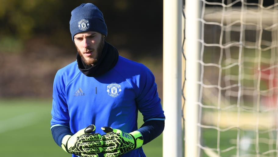 Manchester United's Spanish goalkeeper David de Gea attends a training session at their Carrington base in Manchester, northwest England, on October 19, 2016 ahead of their UEFA Europa League group A football match against Fenerbahce on October 20. / AFP / PAUL ELLIS        (Photo credit should read PAUL ELLIS/AFP/Getty Images)