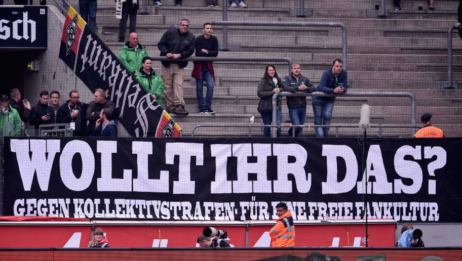 COLOGNE, GERMANY - SEPTEMBER 19:  A banner is seen in the Borussia Moenchengladbach supporters stands during the Bundesliga match between 1. FC Koeln and Borussia Moenchengladbach at RheinEnergieStadion on September 19, 2015 in Cologne, Germany.  (Photo by Dennis Grombkowski/Bongarts/Getty Images)
