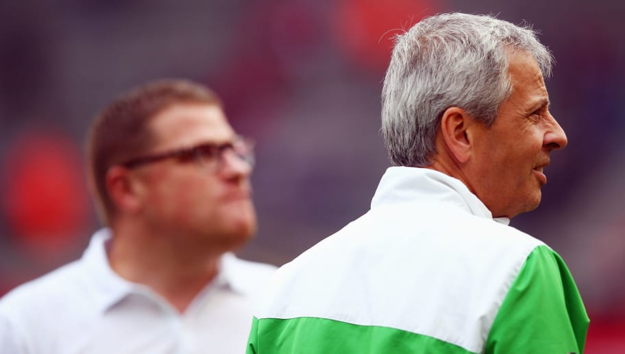 COLOGNE, GERMANY - SEPTEMBER 21:  Head coach Lucien Favre (front) and manager Max Eberl of Moenchengladbach look on prior to the Bundesliga match between 1. FC Koeln and Borussia Moenchengladbach at RheinEnergieStadion on September 21, 2014 in Cologne, Germany.  (Photo by Alex Grimm/Bongarts/Getty Images)