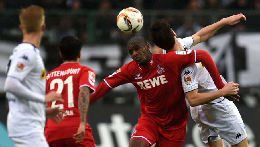 Cologne's French forward Anthony Modeste (C,R) and Moenchengladbach's Norwegian midfielder Havard Nordtveit (R) vie for the ball during the German first division Bundesliga football match Borussia Moenchengladbach vs 1. FC Cologne in Moenchengladbach , western Germany, on February  20, 2016. / AFP / PATRIK STOLLARZ / RESTRICTIONS: DURING MATCH TIME: DFL RULES TO LIMIT THE ONLINE USAGE TO 15 PICTURES PER MATCH AND FORBID IMAGE SEQUENCES TO SIMULATE VIDEO. == RESTRICTED TO EDITORIAL USE == FOR FURTHER QUERIES PLEASE CONTACT DFL DIRECTLY AT + 49 69 650050         (Photo credit should read PATRIK STOLLARZ/AFP/Getty Images)