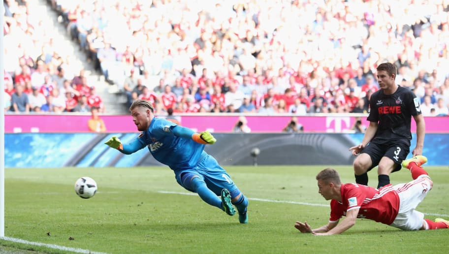 MUNICH, GERMANY - OCTOBER 01: Joshua Kimmich of Muenchen scores his team's first goal past goalkeeper Timo Horn of Koeln during the Bundesliga match between Bayern Muenchen and 1. FC Koeln at Allianz Arena on October 1, 2016 in Munich, Germany.  (Photo by Alex Grimm/Bongarts/Getty Images)