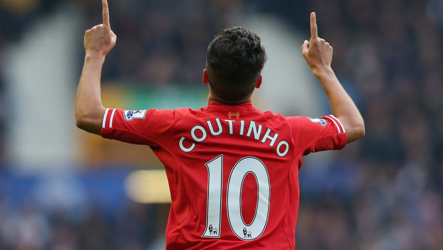 LIVERPOOL, ENGLAND - NOVEMBER 23:  Coutinho of Liverpool celebrates scoring the opening goal during the Barclays Premier League match between Everton and Liverpool at Goodison Park on November 23, 2013 in Liverpool, England.  (Photo by Alex Livesey/Getty Images)