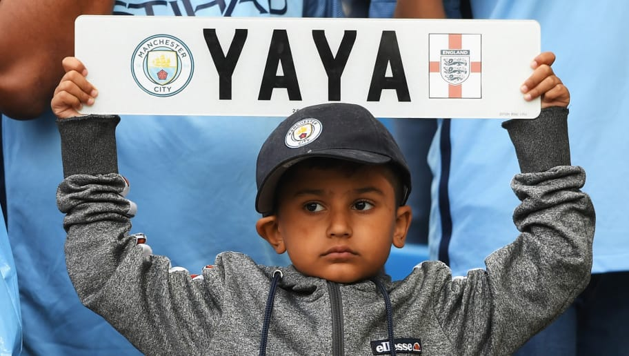 MANCHESTER, ENGLAND - AUGUST 13: A Manchester City fan holds a sign up for Yaya Toure of Manchester City during the Premier League match between Manchester City and Sunderland at Etihad Stadium on August 13, 2016 in Manchester, England.  (Photo by Stu Forster/Getty Images)