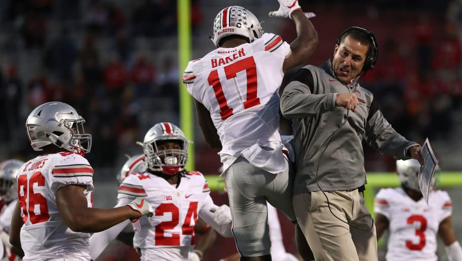 COLLEGE PARK, MD - NOVEMBER 12: Jerome Baker #17 of the Ohio State Buckeyes (L) celebrates with a coach after making a play against the Maryland Terrapins during the second quarter at Capital One Field at Maryland Stadium on November 12, 2016 in College Park, Maryland. (Photo by Patrick Smith/Getty Images)