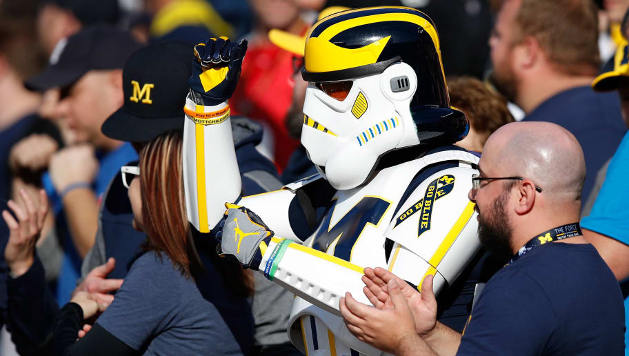 ANN ARBOR, MI - NOVEMBER 05: A Michigan fan in a stormtrooper outfit cheers on the Michigan Wolverines while they play the Maryland Terrapins on November 5, 2016 at Michigan Stadium in Ann Arbor, Michigan. Michigan won the game 59-3. (Photo by Gregory Shamus/Getty Images)