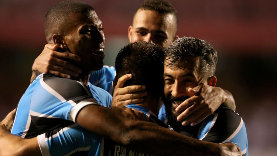 SAO PAULO, BRAZIL - NOVEMBER 17:  Ramiro (C) of Gremio celebrates scoring the first goal with his team during the match between Sao Paulo and Gremio for the Brazilian Series A 2016 at Morumbi Stadium on November 17, 2016 in Sao Paulo, Brazil.  (Photo by Friedemann Vogel/Getty Images)