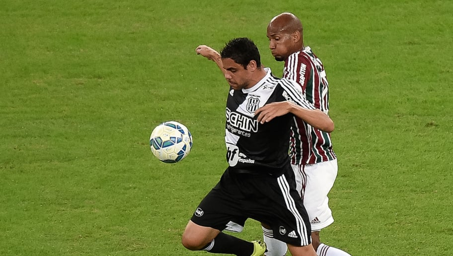RIO DE JANEIRO, BRAZIL - JUNE 24:  Henrique (R) of Fluminense struggles for the ball with a Diego Oliveira of Ponte Preta during a match between Fluminense and Ponte Preta as part of Brasileirao Series A 2015 on June 24, 2015 in Rio de Janeiro, Brazil.  (Photo by Buda Mendes/Getty Images)