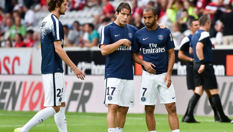 Paris Saint Germain players French midfielder Adrien Rabiot (L), Brasilian defender Maxwell (C) and Brasilian midfielder Lucas Moura (R) talk before the French L1 football match between Lille and Paris Saint Germain - PSG on August 7, 2015 at the Pierre Mauroy Stadium in Villeneuve d'Ascq. AFP PHOTO / PHILIPPE HUGUEN        (Photo credit should read PHILIPPE HUGUEN/AFP/Getty Images)