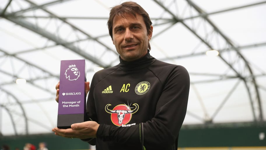 COBHAM, ENGLAND - NOVEMBER 17:  Manager Antonio Conte of Chelsea is awarded the October Manager of the Month at the Chelsea Training Ground on November 17, 2016 in Cobham, England.  (Photo by Christopher Lee/Getty Images for Premier League)