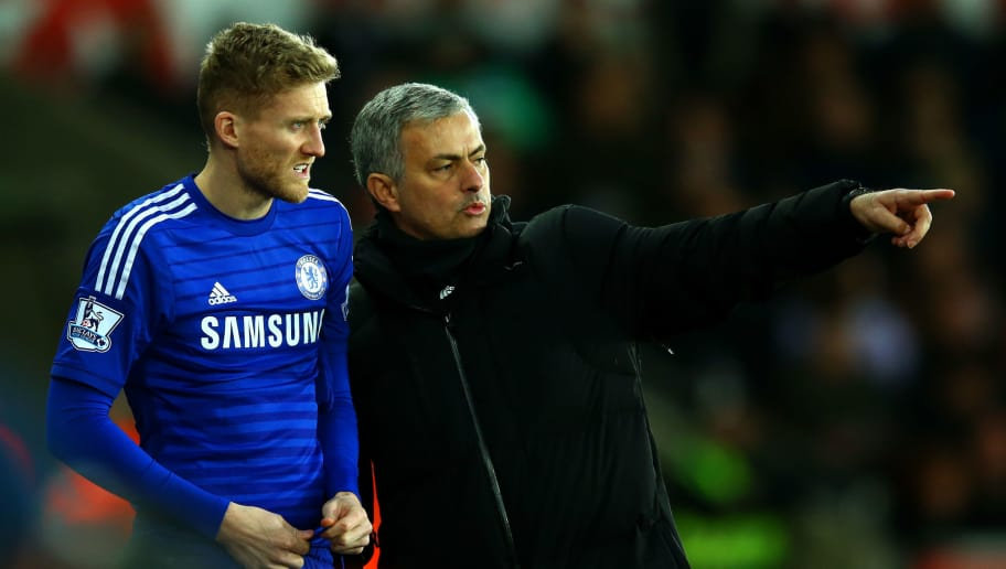 SWANSEA, WALES - JANUARY 17:  Jose Mourinho, manager of Chelsea speaks with Andre Schuerrle of Chelsea as he prepares to gon on during the Barclays Premier League match between Swansea City and Chelsea at Liberty Stadium on January 17, 2015 in Swansea, Wales.  (Photo by Richard Heathcote/Getty Images)