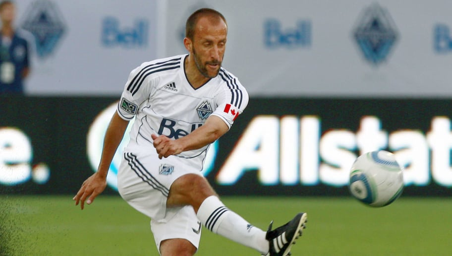 VANCOUVER, CANADA - JULY 30:   Peter Vagenas #33 of the Vancouver Whitecaps FC kicks the ball during their MLS game July 30, 2011 against the Los Angeles Galaxy at Empire Field in Vancouver, British Columbia, Canada. (Photo by Jeff Vinnick/Getty Images)