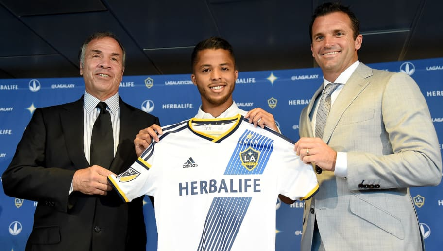 CARSON, CA - AUGUST 04:  (L-R) Head Coach and General Manager Bruce Arena, Giovani Dos Santos #10 of the Los Angeles Galaxy and LA Galaxy President Chris Klein, pose for a photo during a press conference at StubHub Center on August 4, 2015 in Carson, California.  (Photo by Harry How/Getty Images)