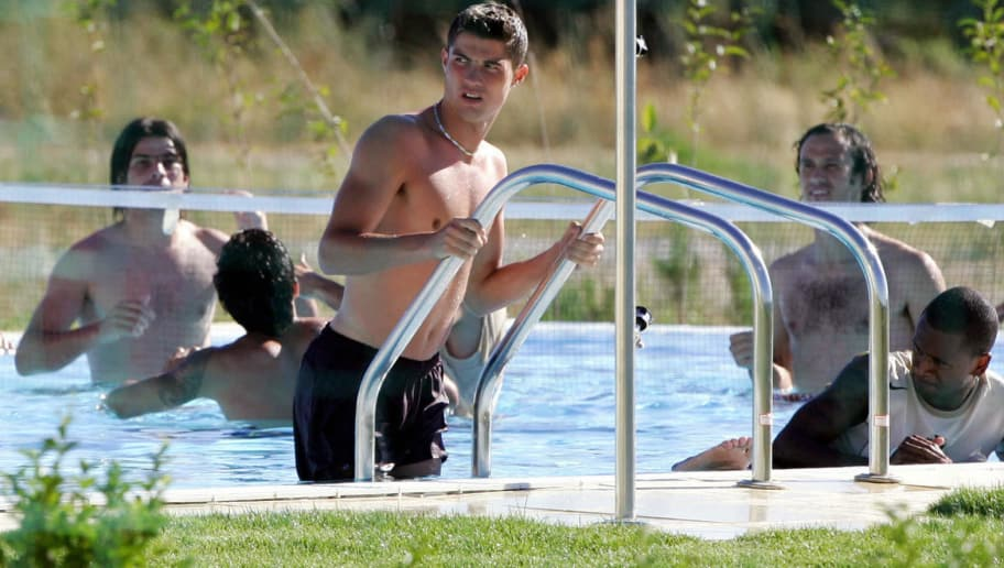 ALCOCHETE, Portugal:  Portuguese forward Cristiano Ronaldo (C) leaves the swimming pool during a training session 26 June 2004, at the Academia Sporting, near Lisbon during the European nations football Championship. Portugal will play 29 June 2004 at Alvalade stadium in Lisbon the semi-final against the winner of the match Denmark vs Czech Republic.     AFP PHOTO/LLUIS GENE  (Photo credit should read LLUIS GENE/AFP/Getty Images)