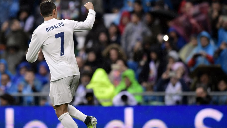 Real Madrid's Portuguese forward Cristiano Ronaldo celebrates his second goal during the Spanish league football match Real Madrid CF vs Real Sporting de Gijon at the Santiago Bernabeu stadium in Madrid on November 26, 2016. / AFP / JAVIER SORIANO        (Photo credit should read JAVIER SORIANO/AFP/Getty Images)