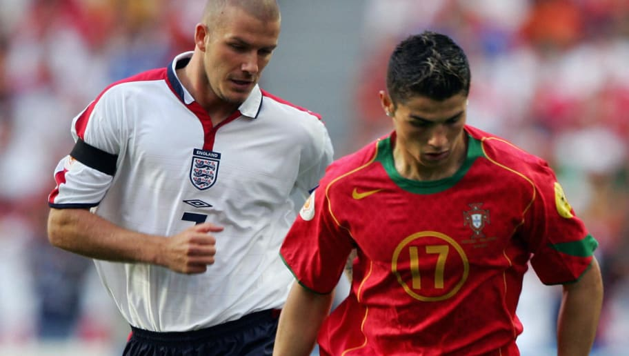 LISBON, Portugal:  Portugal's forward Cristiano Ronaldo (R) fights for the ball with England captain David Beckham, 24 June 2004 during their European Nations Championship quarter-final football match between Portugal and England at the Estadio da Luz in Lisbon. AFP PHOTO Lluis GENE  (Photo credit should read LLUIS GENE/AFP/Getty Images)