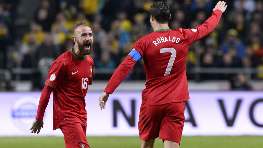 Portugal's midfielder Raul Meireles (L) and Portugal's forward Cristiano Ronaldo celebrate during the FIFA 2014 World Cup playoff football match Sweden vs Portugal at the Friends Arena in Solna near Stockholm on November 19, 2013 . AFP PHOTO/ JONATHAN NACKSTRAND        (Photo credit should read JONATHAN NACKSTRAND/AFP/Getty Images)