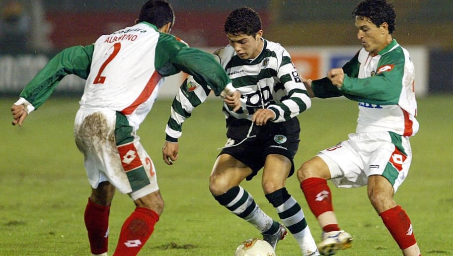 LISBON, PORTUGAL:  Sporting Lisbon's Cristiano Ronaldo (C) vies with Maritimo's Albertino (L) and Joel (R) during the Portuguese league match 15 November 2002 at Alvalade Stadium in Lisbon. (Photo credit should read ANTONIO COTRIM/AFP/Getty Images)