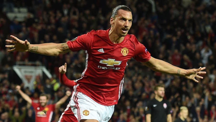 Manchester United's Swedish striker Zlatan Ibrahimovic (C) celebrates scoring his team's first goal during the UEFA Europa League group A football match between Manchester United and Zorya Luhansk at Old Trafford stadium in Manchester, north-west England, on September 29, 2016. / AFP / PAUL ELLIS        (Photo credit should read PAUL ELLIS/AFP/Getty Images)