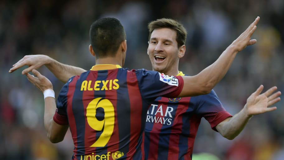 Barcelona's Argentinian forward Lionel Messi (R) and Barcelona's Chilean forward Alexis Sanchez (L) celebrate after scoring during the Spanish league football match FC Barcelona vs Osasuna at the Camp Nou stadium in Barcelona on March 16, 2014.   AFP PHOTO/ LLUIS GENE        (Photo credit should read LLUIS GENE/AFP/Getty Images)