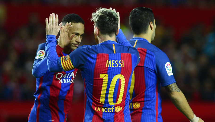 Barcelona's Argentinian forward Lionel Messi (C) celebrates with Barcelona's Brazilian forward Neymar after scoring during the Spanish league football match Sevilla FC vs FC Barcelona at the Ramon Sanchez Pizjuan stadium in Sevilla on November 6, 2016. / AFP / CRISTINA QUICLER        (Photo credit should read CRISTINA QUICLER/AFP/Getty Images)