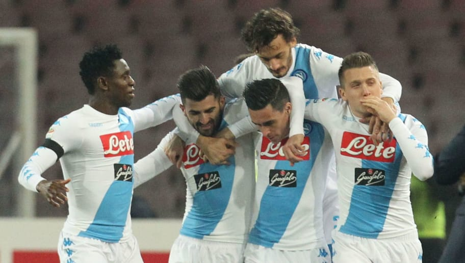 Napoli's midfielder from Poland Piotr Zielinski (R) celebrates with teammates after scoring during the Italian Serie A football match SSC Napoli vs Inter Milan on December 2, 2016 at the San Paolo Stadium. / AFP / CARLO HERMANN        (Photo credit should read CARLO HERMANN/AFP/Getty Images)