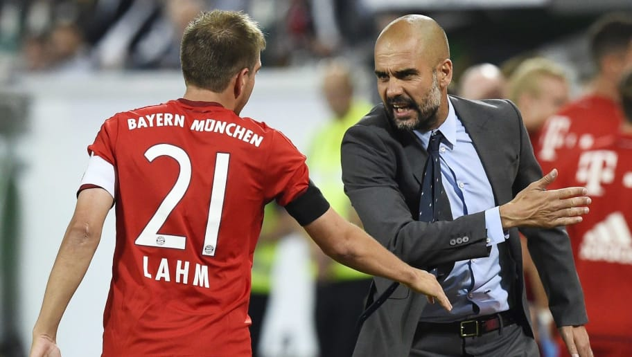 Bayern Munich's Spanish head coach Pep Guardiola (R) talks to Bayern Munich's defender Philipp Lahm during the German Supercup football match VfL Wolfsburg vs Bayern Munich in Wolfsburg, central Germany, on August 1, 2015. AFP PHOTO / TOBIAS SCHWARZ  DFL RULES TO LIMIT THE ONLINE USAGE DURING MATCH TIME TO 15 PICTURES PER MATCH. IMAGE SEQUENCES TO SIMULATE VIDEO IS NOT ALLOWED AT ANY TIME. FOR FURTHER QUERIES PLEASE CONTACT DFL DIRECTLY AT + 49 69 650050.        (Photo credit should read TOBIAS SCHWARZ/AFP/Getty Images)