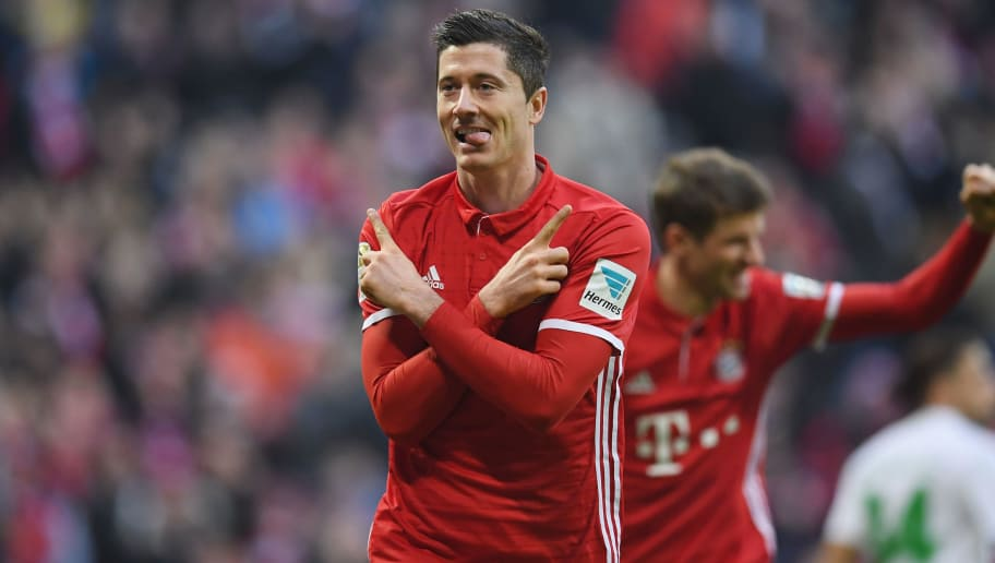 MUNICH, GERMANY - DECEMBER 10:  Robert Lewandowski of Muenchen celebrates his team's second goal during the Bundesliga match between Bayern Muenchen and VfL Wolfsburg at Allianz Arena on December 10, 2016 in Munich, Germany.  (Photo by Matthias Hangst/Bongarts/Getty Images)