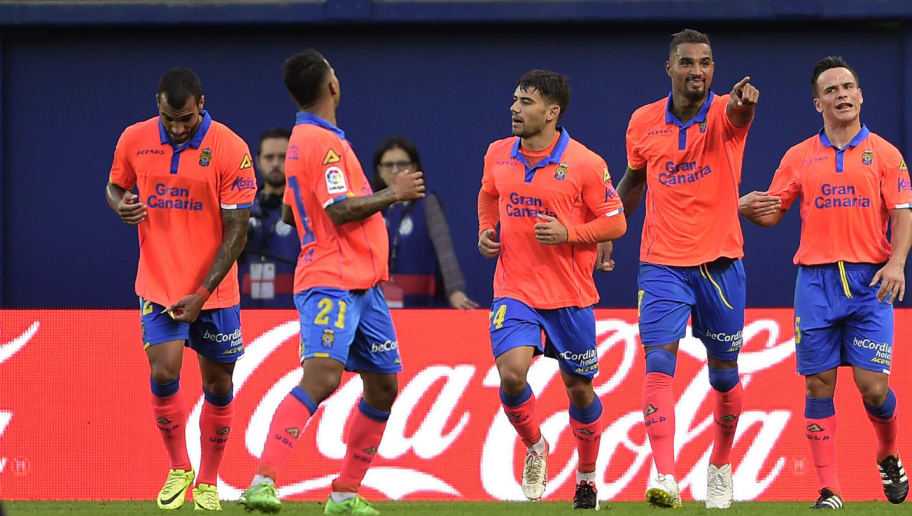 CORRECTION - Las Palmas' German-Ghanaian midfielder Kevin-Prince Boateng (2nd R) celebrates a goal with teammates during the Spanish league football match between Villarreal CF and UD Las Palmas at El Madrigal stadium in Vila-real on October 23, 2016. / AFP / JOSE JORDAN / The erroneous mention[s] appearing in the metadata of this photo by JOSE JORDAN has been modified in AFP systems in the following manner: [Las Palmas' German-Ghanaian midfielder Kevin-Prince Boateng] instead of [Las Palmas' German midfielder Kevin Prince]. Please immediately remove the erroneous mention[s] from all your online services and delete it (them) from your servers. If you have been authorized by AFP to distribute it (them) to third parties, please ensure that the same actions are carried out by them. Failure to promptly comply with these instructions will entail liability on your part for any continued or post notification usage. Therefore we thank you very much for all your attention and prompt action. We are sorry for the inconvenience this notification may cause and remain at your disposal for any further information you may require.        (Photo credit should read JOSE JORDAN/AFP/Getty Images)