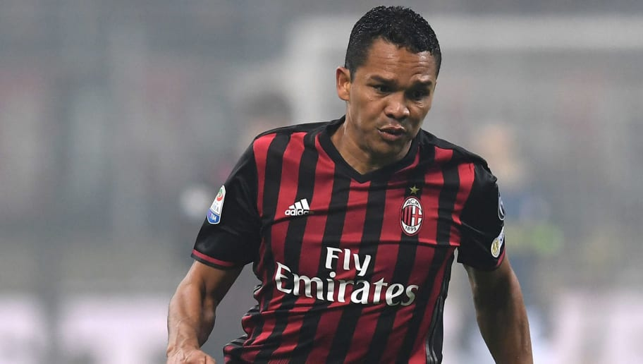 MILAN, ITALY - NOVEMBER 20:  Carlos Bacca of AC Milan in action during the Serie A match between AC Milan and FC Internazionale at Stadio Giuseppe Meazza on November 20, 2016 in Milan, Italy.  (Photo by Valerio Pennicino/Getty Images)