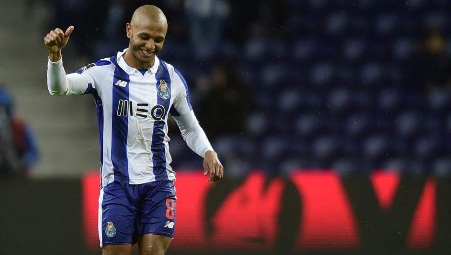 Porto's Algerian forward Yacine Brahimi celebrates after scoring a goal during the Portuguese league football match FC Porto vs CS Maritimo at the Dragao stadium in Porto on December 15, 2016. / AFP / MIGUEL RIOPA        (Photo credit should read MIGUEL RIOPA/AFP/Getty Images)