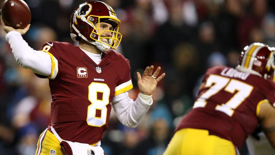 LANDOVER, MD - DECEMBER 19: Quarterback Kirk Cousins #8 of the Washington Redskins passes the ball while teammate guard Shawn Lauvao #77 of the Washington Redskins blocks against the Carolina Panthers in the first quarter at FedExField on December 19, 2016 in Landover, Maryland. (Photo by Patrick Smith/Getty Images)