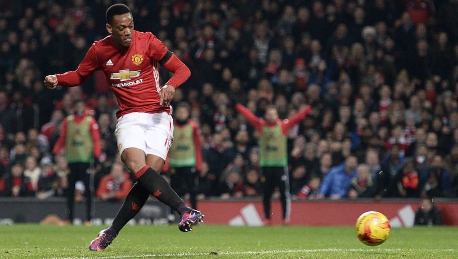 Manchester United's French striker Anthony Martial scores his team's thrid goal during the EFL (English Football League) Cup quarter-final football match between Manchester United and West Ham United at Old Trafford in Manchester, north west England, on November 30, 2016. / AFP / Oli SCARFF / RESTRICTED TO EDITORIAL USE. No use with unauthorized audio, video, data, fixture lists, club/league logos or 'live' services. Online in-match use limited to 75 images, no video emulation. No use in betting, games or single club/league/player publications.  /         (Photo credit should read OLI SCARFF/AFP/Getty Images)
