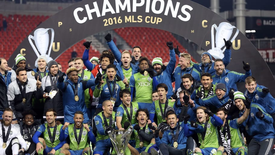 Seattle Sounders celebrate their MLS Cup final victory over Toronto FC at BMO Field on December 10, 2016 in Toronto. / AFP / Cole Burston        (Photo credit should read COLE BURSTON/AFP/Getty Images)