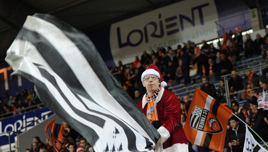 A Lorient's fan disguised as Santa Claus waves a Brittany flag before the French L1 football match between Lorient (FCL) and Nantes (FCN) on December 20, 2014 at the Moustoir stadium in Lorient, western France. AFP PHOTO / JEAN-SEBASTIEN EVRARD        (Photo credit should read JEAN-SEBASTIEN EVRARD/AFP/Getty Images)