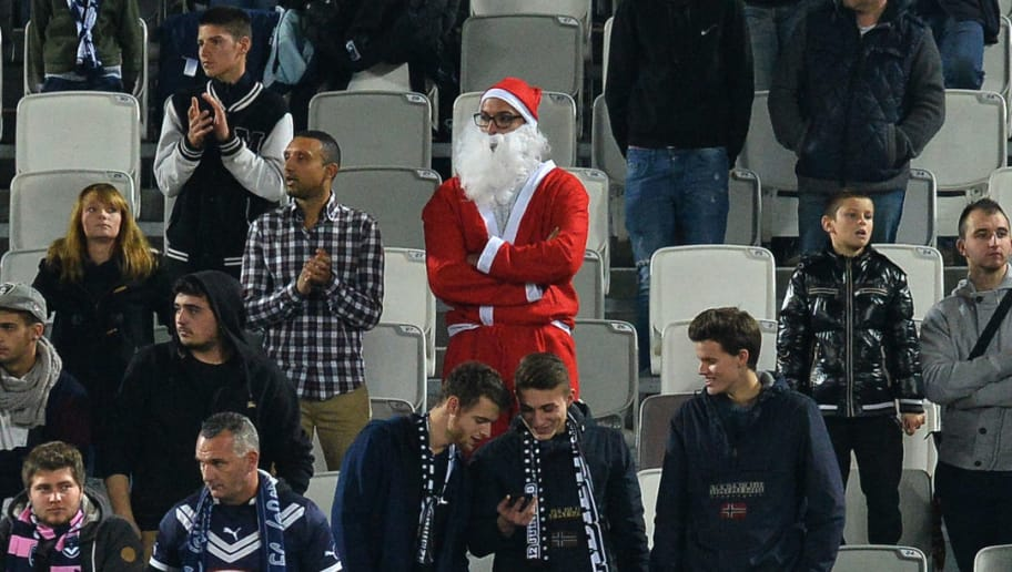 A supporter dressed as Santa Claus attends the French League Cup football match between Bordeaux and Monaco on December 16, 2015 at the Matmut Atlantique stadium in Bordeaux, southwestern France. AFP PHOTO / NICOLAS TUCAT / AFP / NICOLAS TUCAT        (Photo credit should read NICOLAS TUCAT/AFP/Getty Images)