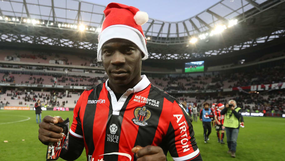 Nice's Italian forward Mario Balotelli, wearing a Santa Claus bonnet, walks on the pitch at the end of the French L1 football match Nice (OGCN) vs Dijon (DFCO) on December 18, 2016 at the Allianz Riviera stadium in Nice, southeastern France.  / AFP / VALERY HACHE        (Photo credit should read VALERY HACHE/AFP/Getty Images)