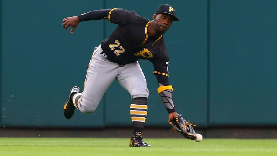 ST. LOUIS, MO - OCTOBER 2: Andrew McCutchen #22 of the Pittsburgh Pirates misplays a fly ball against the St. Louis Cardinals in the third inning at Busch Stadium on October 2, 2016 in St. Louis, Missouri.  (Photo by Dilip Vishwanat/Getty Images)