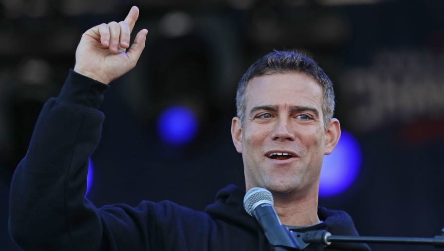 CHICAGO, IL - NOVEMBER 04:  President Theo Epstein of the Chicago Cubs speaks to the crowd during the Chicago Cubs victory celebration in Grant Park on November 4, 2016 in Chicago, Illinois. The Cubs won their first World Series championship in 108 years after defeating the Cleveland Indians 8-7 in Game 7. (Photo by Jonathan Daniel/Getty Images)