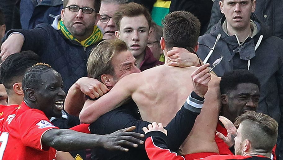 With his shirt off, Liverpool's English midfielder Adam Lallana celebrates scoring their late winning goal with Liverpool's German manager Jurgen Klopp (C) holding his glasses during the English Premier League football match between Norwich City and Liverpool at Carrow Road in Norwich, eastern England, on January 23, 2016. Liverpool won the game 5-4. AFP PHOTO / LINDSEY PARNABY  RESTRICTED TO EDITORIAL USE. No use with unauthorized audio, video, data, fixture lists, club/league logos or 'live' services. Online in-match use limited to 75 images, no video emulation. No use in betting, games or single club/league/player publications. / AFP / LINDSEY PARNABY        (Photo credit should read LINDSEY PARNABY/AFP/Getty Images)