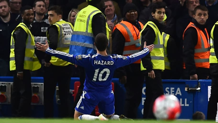 Chelsea's Belgian midfielder Eden Hazard celebrates scoring their second goal to level the score at 2-2 during the English Premier League football match between Chelsea and Tottenham Hotspur at Stamford Bridge in London on May 2, 2016. / AFP / BEN STANSALL / RESTRICTED TO EDITORIAL USE. No use with unauthorized audio, video, data, fixture lists, club/league logos or 'live' services. Online in-match use limited to 75 images, no video emulation. No use in betting, games or single club/league/player publications.  /         (Photo credit should read BEN STANSALL/AFP/Getty Images)