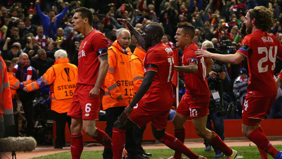 LIVERPOOL, ENGLAND - APRIL 14:  Dejan Lovren of Liverpool celebrates scoring his team's fourth goal with his team mates during the UEFA Europa League quarter final second leg match between Liverpool and Borussia Dortmund at Anfield on April 14, 2016 in Liverpool, United Kingdom.  (Photo by Clive Brunskill/Getty Images)