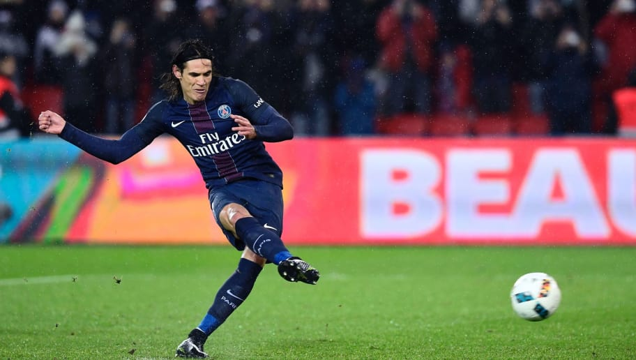 Paris Saint-Germain's Uruguayan forward Edinson Cavani kicks a penalty and scores during the French L1 football match between Paris Saint-Germain (PSG) and Lorient (FCL) at the Parc des Princes stadium in Paris, on December 21, 2016. / AFP / MIGUEL MEDINA (Photo credit should read MIGUEL MEDINA/AFP/Getty Images)