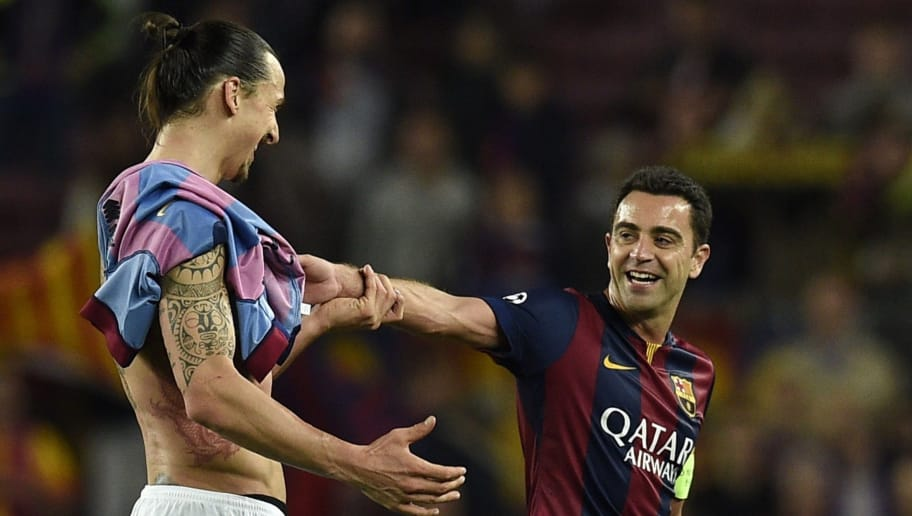 Paris Saint-Germain's Swedish forward Zlatan Ibrahimovic (L) jokes with Barcelona's midfielder Xavi Hernandez (R) at the end of the UEFA Champions League quarter-finals second leg football match FC Barcelona vs Paris Saint-Germain at the Camp Nou unior stadium in Barcelona on April 21, 2015. Barcelona won 2-0 and get qualified for the semis. AFP PHOTO/ LLUIS GENE (Photo credit should read LLUIS GENE/AFP/Getty Images)