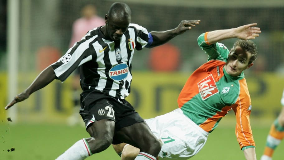 BREMEN, GERMANY - FEBRUARY 22: Miroslav Klose (R) of Werder Bremen and Lilian Thuram (L) of Juventus fight for the ball during the UEFA Champions League round sixteen first leg match between Werder Bremen and Juventus at the Weser Stadium on February 22, 2006 in Bremen, Germany. (Photo by Martin Rose/Bongarts/Getty Images)