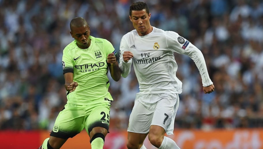Manchester City's Brazilian midfielder Fernandinho (L) vies with Real Madrid's Portuguese forward Cristiano Ronaldo during the UEFA Champions League semi-final second leg football match Real Madrid CF vs Manchester City FC at the Santiago Bernabeu stadium in Madrid, on May 4, 2016. / AFP / PAUL ELLIS        (Photo credit should read PAUL ELLIS/AFP/Getty Images)