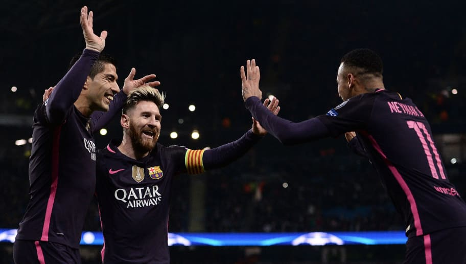 TOPSHOT - Barcelona's Argentinian striker Lionel Messi (C) celebrates scoring his team's first goal with Barcelona's Uruguayan striker Luis Suarez (L) and Barcelona's Brazilian striker Neymar during the UEFA Champions League group C football match between Manchester City and Barcelona at the Etihad Stadium in Manchester, north west England on November 1, 2016. / AFP / OLI SCARFF        (Photo credit should read OLI SCARFF/AFP/Getty Images)